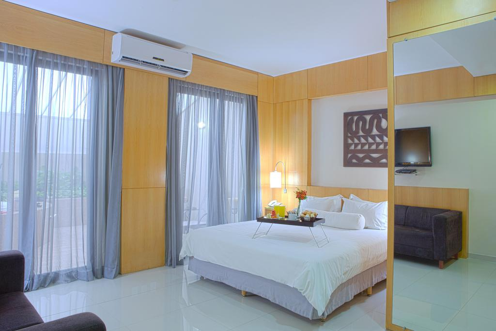 Suíte de luxo no hotel Royal Golden Savassi em Belo Horizonte.
